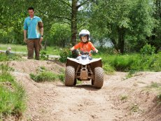 Driving a mini quad Bispinger Heide Soltau Center Parcs